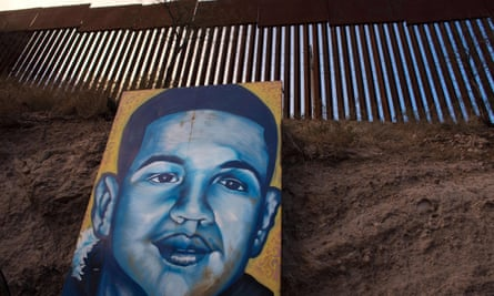 A portrait of 16-year-old José Antonio Elena Rodríguez, who was shot and killed by a US border patrol agent, is displayed on the Nogales street where he was killed.