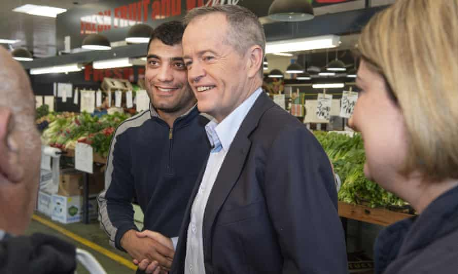 Bill Shorten talks to shoppers and traders at a market in Melbourne on Saturday
