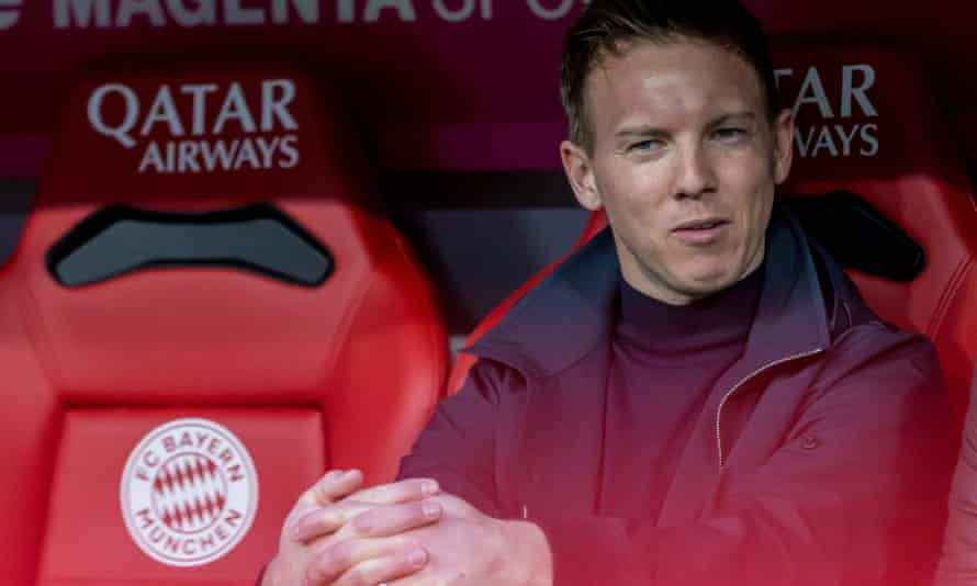 Julian Nagelsmann sits in the Allianz Arena dugout at Bayern Munich as manager of RB Leipzig