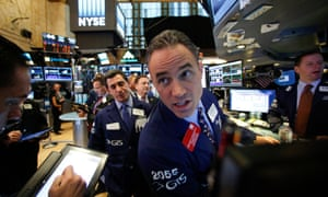 Traders on the floor of the New York Stock Exchange as the US votes