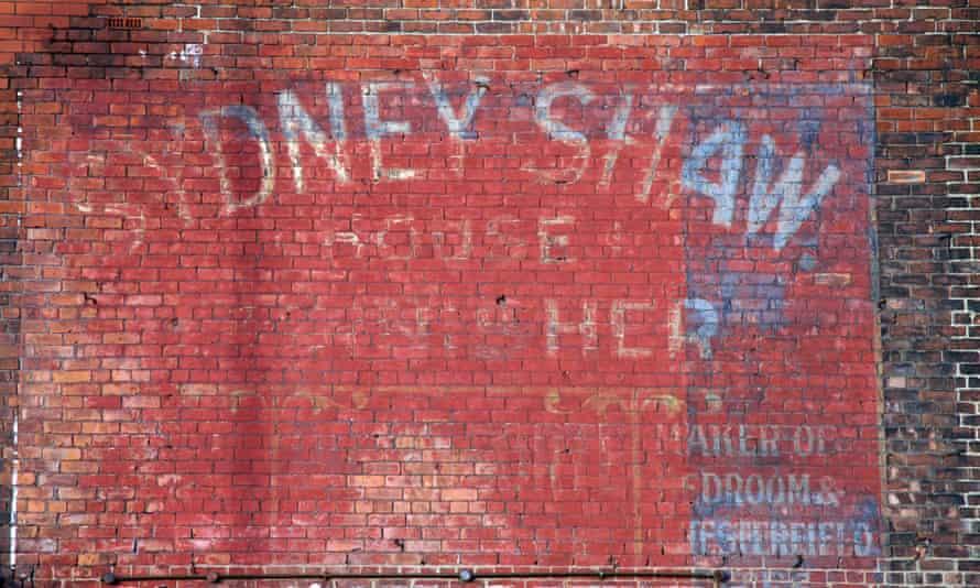 A faded sign on Market Street, Stalybridge.