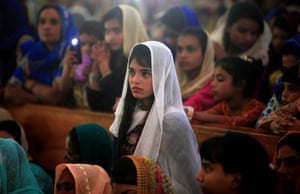 A girl attends the Easter mass at the Fatima Church