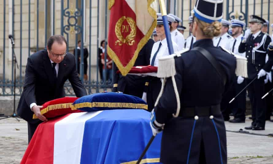 French president Francois Hollande at a memorial ceremony honoring the police couple killed in France this week.