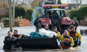 A resident of Moorland is rescued during flooding of the Somerset Levels, UK, February 2014