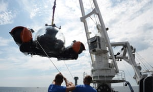 The C-Explorer submersible lifted out of the water by the Russian Geographical Society's expedition vessel