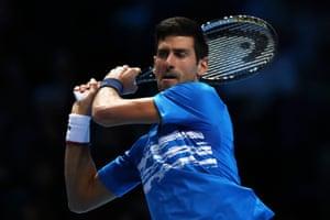 Novak Djokovic bashes a backhand to Dominic Thiem.