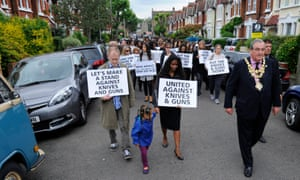Friends and family of Lewis Elwin, who was fatally stabbed in April 2016, stage an anti-knife crime march before his funeral in Tooting, south-west London