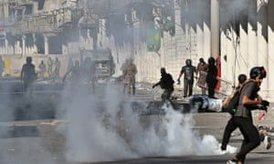 Iraqi riot police fire tear gas to disperse anti-government protesters.