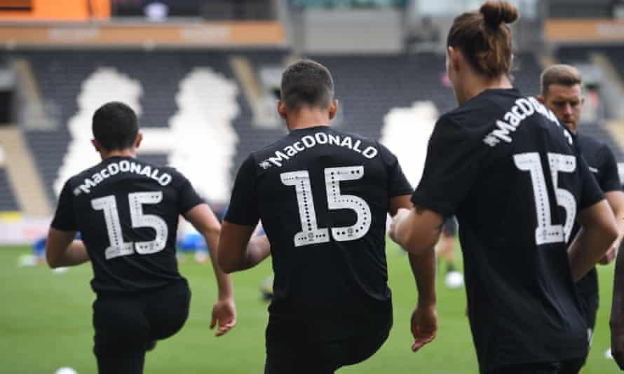 Hull players warm up in MacDonald shirts last September.