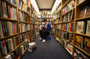 An Oxford University student peruses the books in Blackwell bookshop.