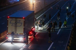 Refugees block a truck on the highway