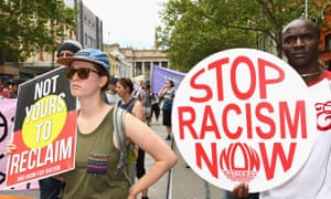 Anti-racism protesters gather in Melbourne on 20 November to counter another rally held to celebrate Donald Trump's US election victory.