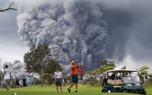 Hawaii's Kilauea Volcano Erupts Forcing EvacuationsPeople play golf as an ash plume rises in the distance from the Kilauea volcano on Hawaii's Big Island on May 15, 2018 in Hawaii Volcanoes National Park, Hawaii.