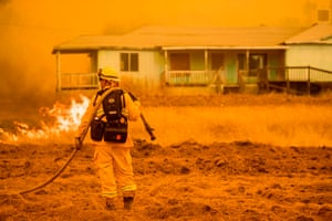 Mariposa, USA A firefighter works to protect a home. The Detwiler fire in California, which has burned more than 45,000 acres and destroyed eight structures, is currently at 7 percent containment