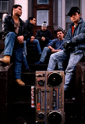 Five men with a ghetto blaster on a stoop