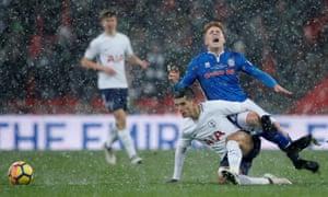 Rochdale's Callum Camps is fouled by Tottenham's Erik Lamela.