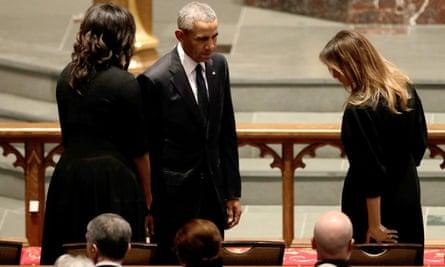 The Obamas greet Melania Trump.
