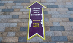A sign telling people to practise social distancing  in Bracknell, UK.