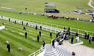 A general view from the royal box of a sparsely populated viewing area as the runners and riders in the Investec Handicap go past.