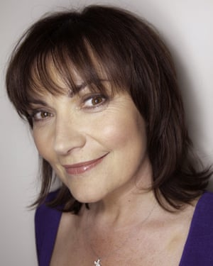 Lorraine Kelly looks at the camera in a blue dress