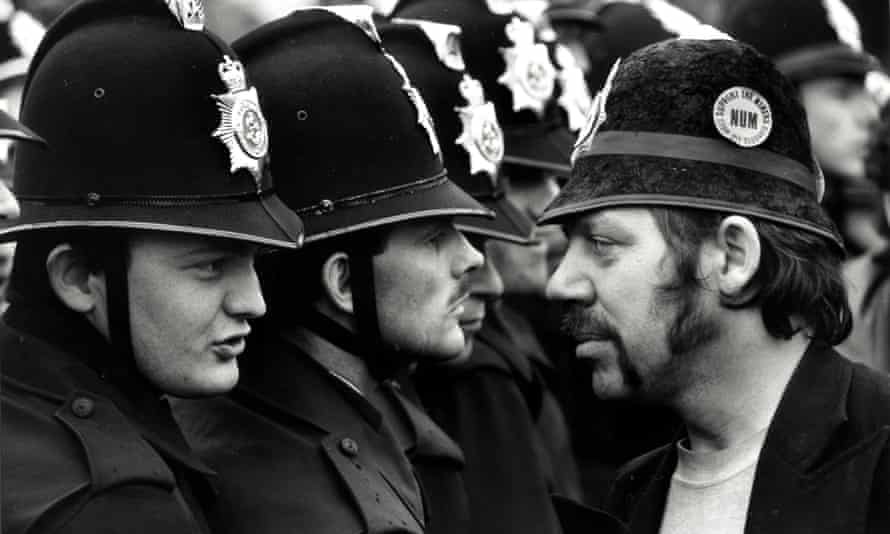 Face off between an NUM picket and lines of police, who have removed their numbers from their coat shoulders, in what became known as the Battle of Orgreave.