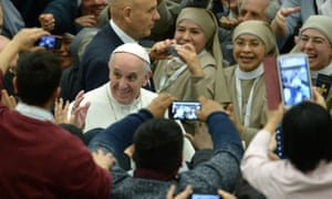 Close up ready … Pope Francis greets the crowds, 1 February.