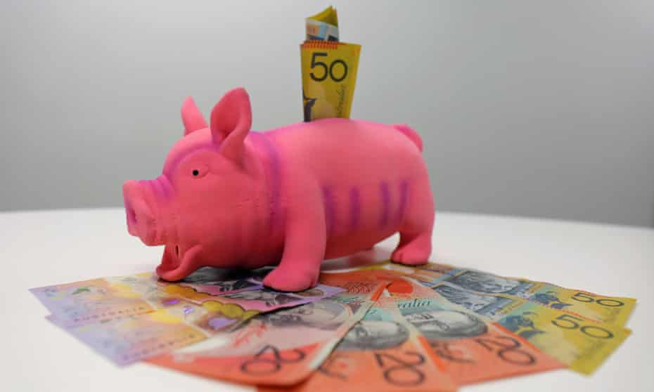 a piggy bank with Australian notes in it