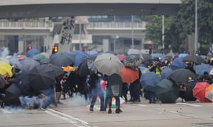 Protesters hold umbrellas as shields during a protest in Hong Kong