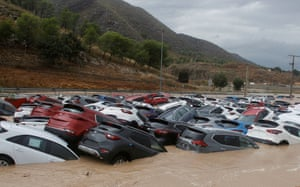 Cars submerged in water after strong rainfall known as the 'gota fria' (cold drop) hit Orihuela