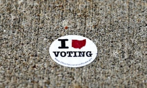 An old voting sticker remains stuck to the sidewalk outside the board of elections office in Medina, Ohio.