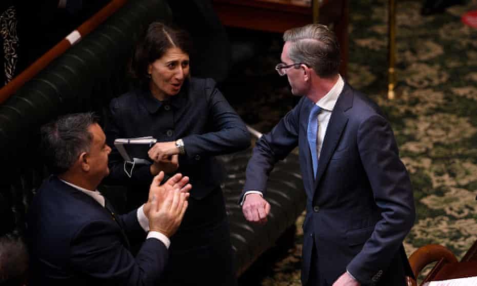NSW premier Gladys Berejiklian and deputy premier John Barilaro congratulate treasurer Dominic Perrottet after delivering the state budget in June