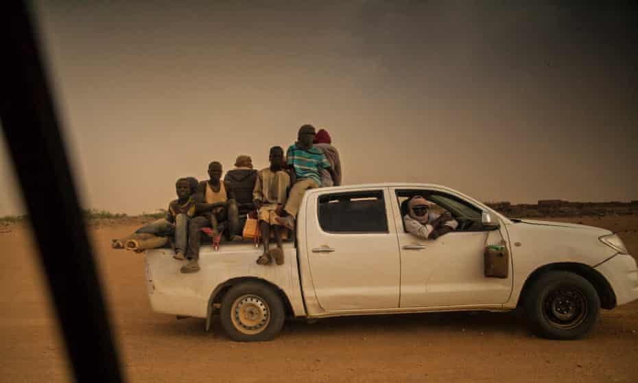A pick-up truck filled with migrants in Agadez. The journey should take three days – but often takes much longer