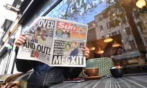 A man reading the Sun newspaper, 9 January 2020