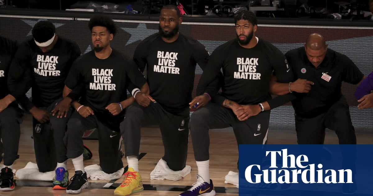 Players and coaches kneel for anthem as NBA reopens following 140-day hiatus