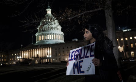 A Daca recipient joins a rally outside the US Capitol amid the government shutdown.
