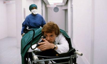 Malcolm McDowell in Britannia Hospital, 1982, written by David Sherwin