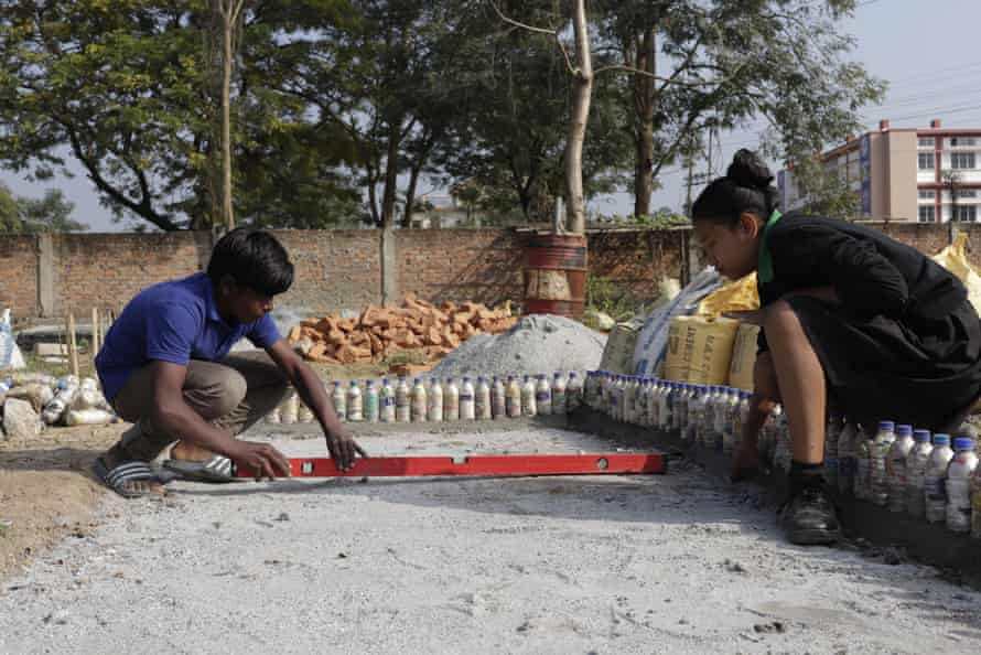 The plastic waste collected from students is stuffed into bottles to make eco-bricks, which are used for building projects.