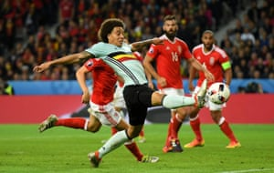 Axel Witsel stretches but fails to reach the ball.