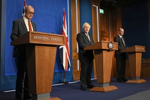 Boris Johnson (centre) at the press conference with Chris Whitty (right) and Patrick Vallance.