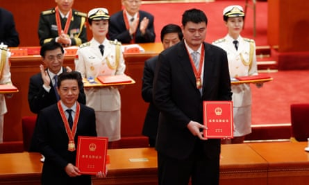 Retired Chinese basketball player Yao Ming (right and Baidu's chief executive officer, Robin Li, attend a meeting held to celebrate the 40th anniversary of China's reform and opening up at the Great Hall of the People in Beijing.