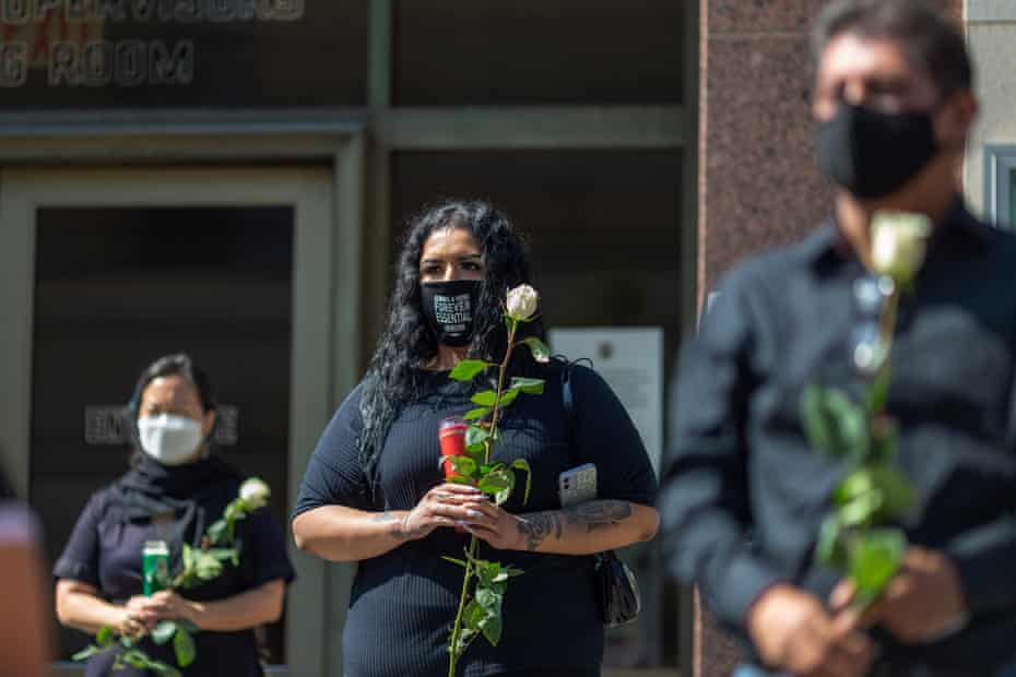 Mourners attend a memorial ceremony held by loved ones of mostly Latino essential workers killed by Covid in Los Angeles on 31 August 2020.