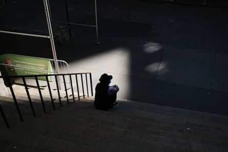 A man pauses in front of the New York Stock Exchange on Wall Street as the coronavirus keeps financial markets and businesses mostly closed.
