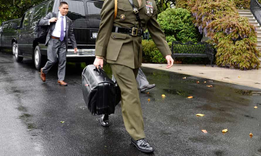 A military aide carries the 'nuclear football' at the White House in April.