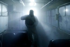 Yerevan, ArmeniaA man in protective gear disinfects a bus