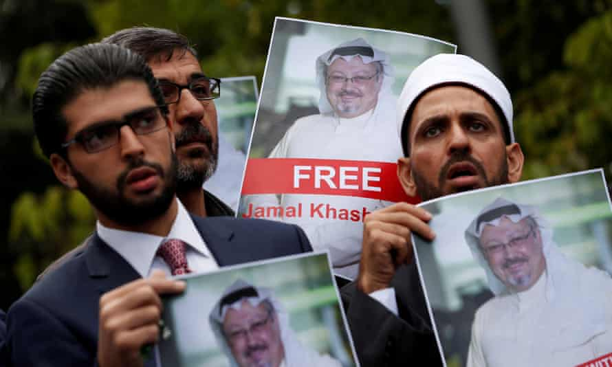 Rights activists and friends of Jamal Khashoggi hold his pictures during a protest outside the Saudi consulate in Istanbul.