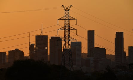 City skyline with electricity transmission tower