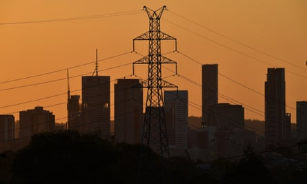 silhouette of of electricity tower and brisbane city skyline