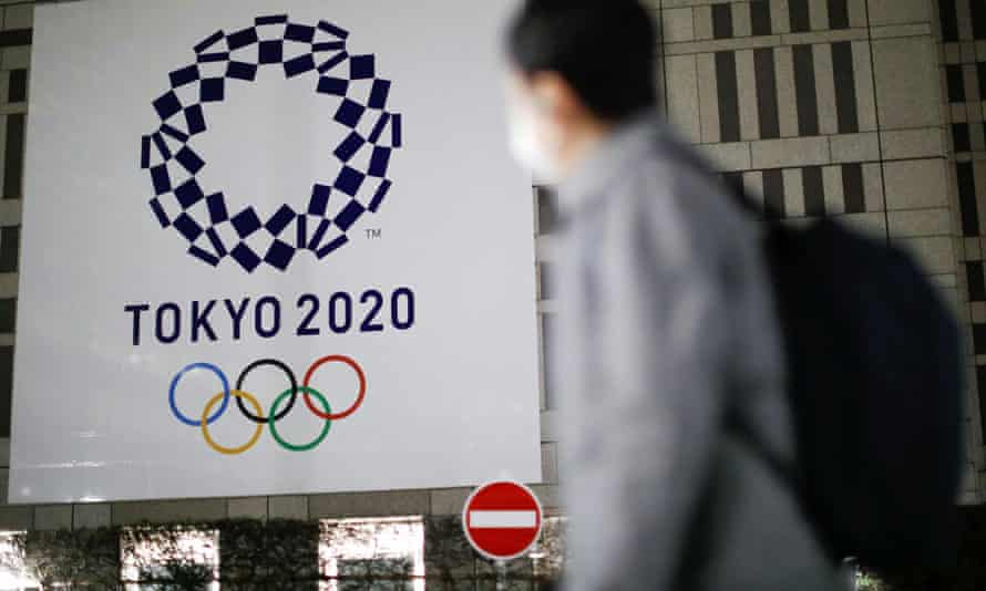 The logo of Tokyo 2020 Olympic Games is seen through signboards in the Japanese capital.