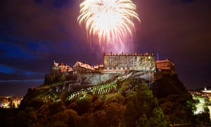 Fireworks over Edinburgh Castle, lit up with digital projections in an event called Deep Time that kicks off the Edinburgh international festival