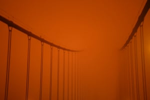 The Golden Gate Bridge in the red and amber darkness, taken at noon on Wednesday